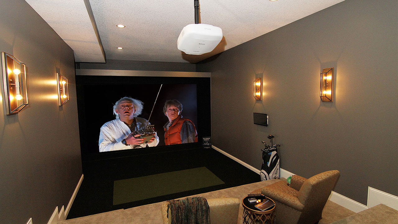 Home theater in custom home by Neighborhood Builders